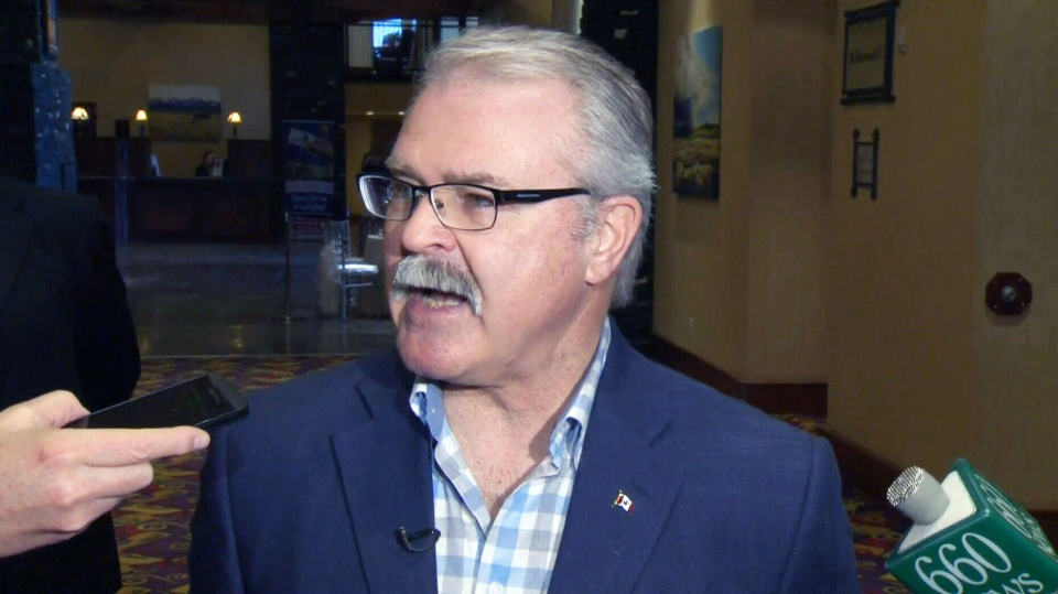 Agriculture Minister Gerry Ritz speaks to reporters in Calgary on Friday, Feb. 13, 2015.