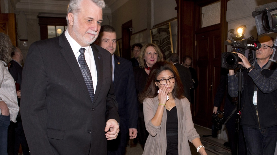 Ensaf Haider, right, wife of Raif Badawi, walks with Quebec Premier Philippe Couillard, left, to his office, after the legislature voted unanimously in favour of a motion to free her husband from a Saudi Arabia jail, at the legislature in Quebec City, Wednesday, Feb. 11, 2015. (Jacques Boissinot / THE CANADIAN PRESS)