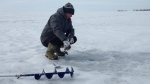 An ice fisher tries his luck on Mitchell's Bay on Feb 13, 2015. (Chris Campbell / CTV Windsor)