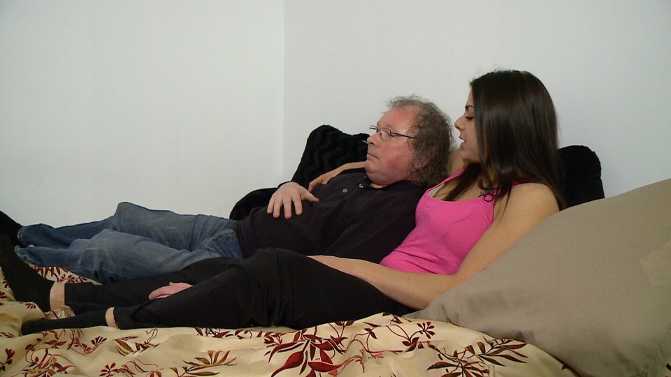 Professional cuddler, Maya Arbach, cuddles with client, Kevin Farrell.