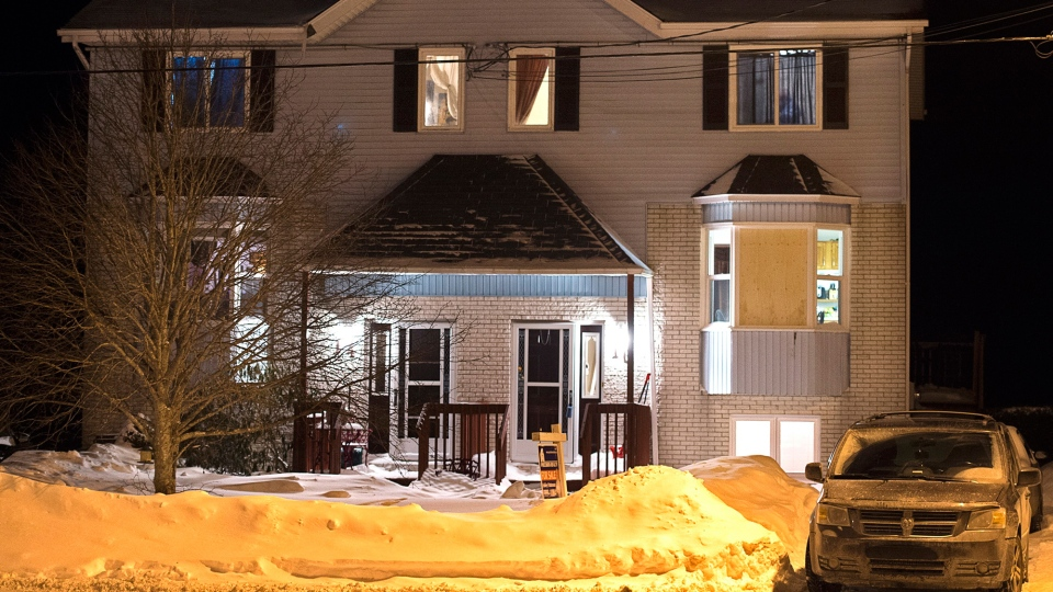 A house is seen on Tiger Maple Drive in Timberlea, N.S, a Halifax suburb, where police found a deceased person early Friday, Feb. 13, 2015. (Andrew Vaughan / THE CANADIAN PRESS)