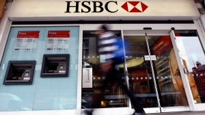 A pedestrian passes a branch of HSBC bank in London, U.K., Feb. 27, 2012. (AP / Kirsty Wigglesworth, File)