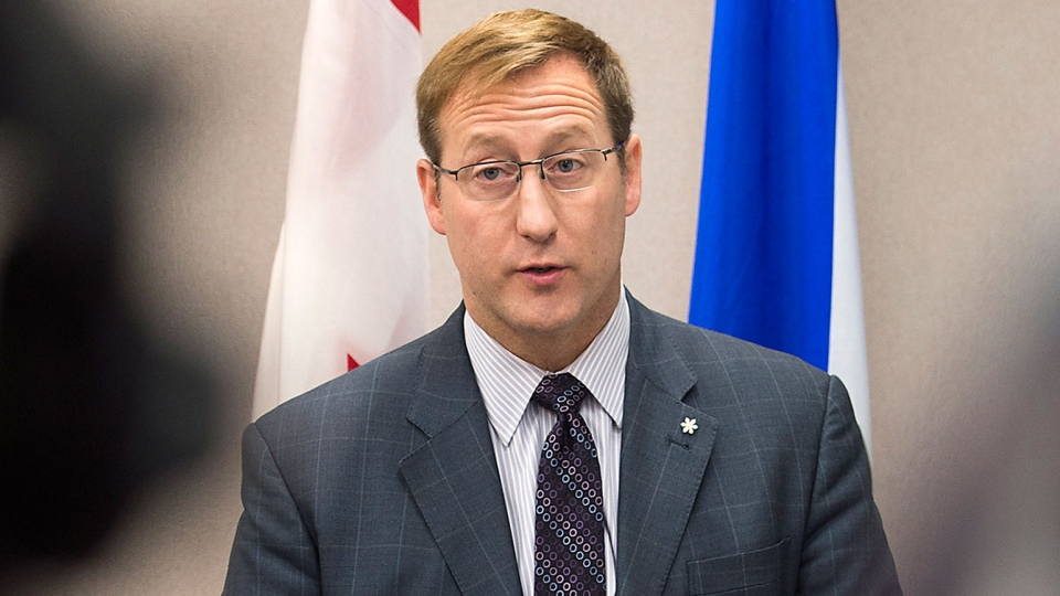 Justice Minister Peter MacKay addresses a news conference, regarding a foiled mass murder plan, in Halifax on Saturday, Feb. 14, 2015. (Andrew Vaughan / THE CANADIAN PRESS)