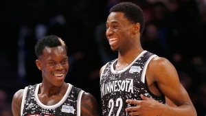 World Team's Dennis Schroder, left, of the Atlanta Hawks, and Andrew Wiggins, of the Minnesota Timberwolves, talk during the second half against the U.S. Team in NBA basketball's Rising Stars Challenge, in New York on Friday, Feb. 13, 2015. (AP / Julio Cortez)