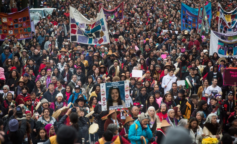 Hundreds of people march through the Downtown Eastside during the 25th annual Women's Memorial March in Vancouver, B.C., on Saturday February 14, 2015. (Darryl Dyck / THE CANADIAN PRESS)