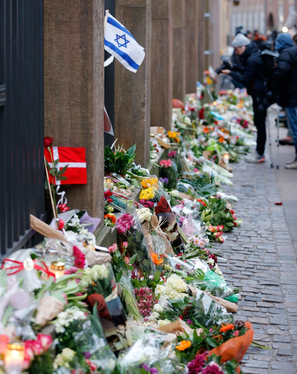 Flowers lay in front of the synagogue where one person was killed in Copenhagen, Denmark, Sunday, Feb. 15, 2015. (AP / Michael Probst)