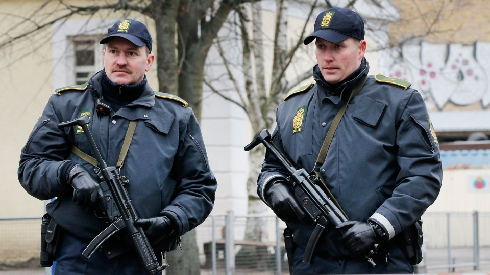 A Danish police officers secure near to where a man was shot dead in Copenhagen, Denmark on Sunday, Feb. 15, 2015. (AP / Michael Probst)