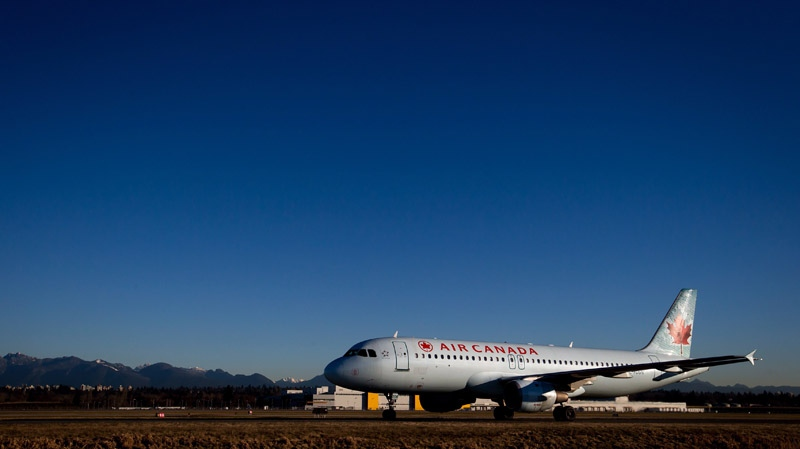 An Air Canada Airbus A320-200 plane taxis at Vancouver International Airport in Richmond, B.C., on Monday, Feb. 3, 2014. (THE CANADIAN PRESS/Darryl Dyck)