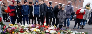 Mourners gather after shootings in Copenhagen