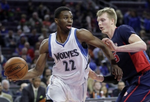 Minnesota Timberwolves' Andrew Wiggins (22) looks to pass the ball against Detroit Pistons' Kyle Singler, right, during the first half of an NBA basketball game on Feb. 8, 2015, in Auburn Hills, Mich. (Duane Burleson / AP Photo)