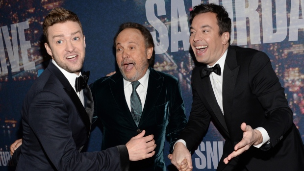 Justin Timberlake, from left, Billy Crystal and Jimmy Fallon arrive at the Saturday Night Live 40th Anniversary Special at Rockefeller Plaza on Sunday, Feb. 15, 2015, in New York. (AP / Invision / Evan Agostini)