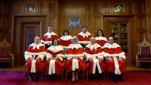 The Supreme Court justices pose for a group photo during the official welcoming ceremony for Supreme Court of Canada Justice Suzanne Cote at the Supreme Court in Ottawa, Tuesday Feb.10, 2015. (Adrian Wyld / THE CANADIAN PRESS)