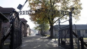 "The entrance with the inscription ""Arbeit Macht Frei"" (Work Sets You Free) the former German Nazi death camp of Auschwitz is pictured in Oswiecim, Poland, Oct. 19, 2012. (AP / Czarek Sokolowski, File)"