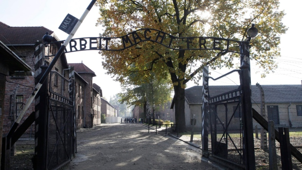 """The entrance with the inscription """"Arbeit Macht Frei"""" (Work Sets You Free) the former German Nazi death camp of Auschwitz is pictured in Oswiecim, Poland, Oct. 19, 2012. (AP / Czarek Sokolowski, File)"""