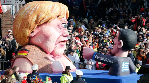 A carnival float depicts Russia's president Putin as a robot out of control named Putinator, during the traditional carnival parade in Cologne, western Germany, Monday, Feb. 16, 2015. (AP / Martin Meissner)