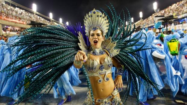 A performer from the Academicos do Grande Rio samba school parades during carnival celebrations at the Sambadrome in Rio de Janeiro, Brazil, early Monday, Feb. 16, 2015. (AP / Leo Correa)