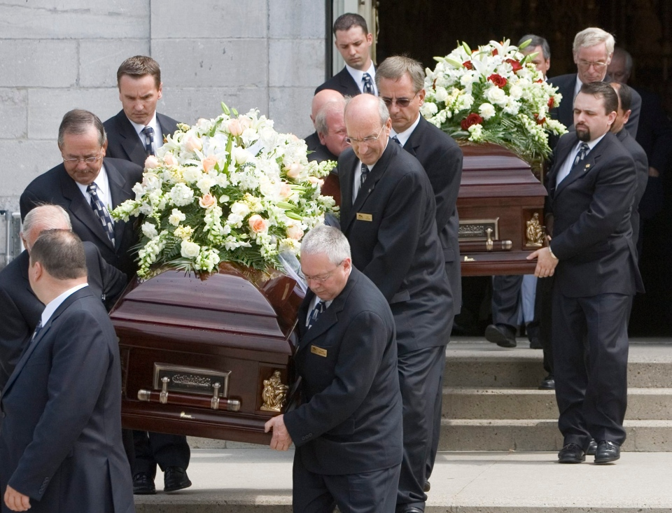 Pallbearers carry the caskets of retired chief justice Alban Garon and his wife Raymonde following funeral services for the two at Notre Dame Basilica in Ottawa Tuesday July 10, 2007. The two along with neighbor Jean Marie Beniskos were discovered murdered in their high end condo on June 30, 2007. (Tom Hanson / THE CANADIAN PRESS)