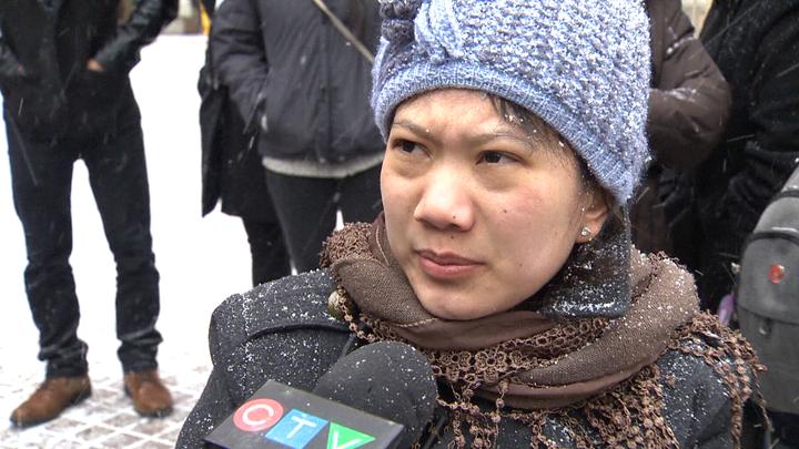 Maria Victoria Venancio speaks to reporters in Edmonton on Monday, February 16, 2015.