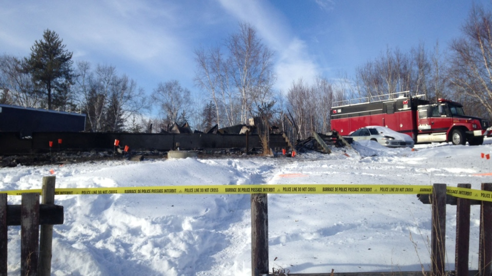 Police tape blocks the scene of a fatal house fire on the Makwa Sahgaiehcan First Nation. (Jeremy Thompson/Newcap Television)