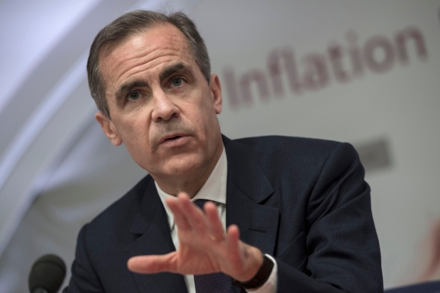 Bank of England governor Mark Carney speaking during a media presentation about its quarterly GDP and inflation forecasts at the Bank of England in London, Thursday Feb. 12, 2015. . (ASSOCIATED PRESS /Anthony Devlin, Pool)
