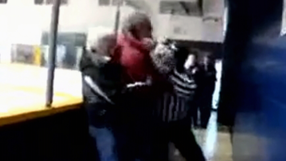 Parents and referees wrestle during an incident at a Vancouver Island minor hockey game.
