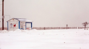 A shuttered beach shack on Chicago's North Avenue Beach is partially buried in snow, as more snow falls on January 8, 2015. (AP / Teresa Crawford)