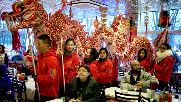 Dragon dancers perform inside a restaurant in the Chinatown district of Paris Thursday, Feb. 19, 2015. (AP / Thibault Camus)
