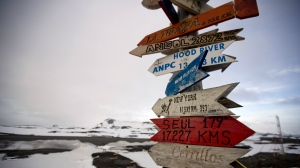 Wooden arrows show the distances to various cities near Chile's Escudero station on King George Island, Antarctica on Jan. 20, 2015. (AP / Natacha Pisarenko)