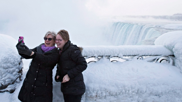 Tourists at the 'Horseshoe' Falls in Niagara Falls