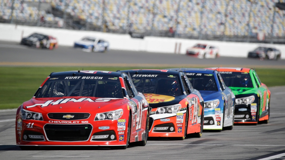 Drivers, from front to back, Kurt Busch, Tony Stewart, Dale Earnhardt Jr. and Danica Patrick, wait their turn to go out on the track during a practice session for the Daytona 500 in Daytona Beach, Fla. (ASSOCIATED PRESS /John Raoux)