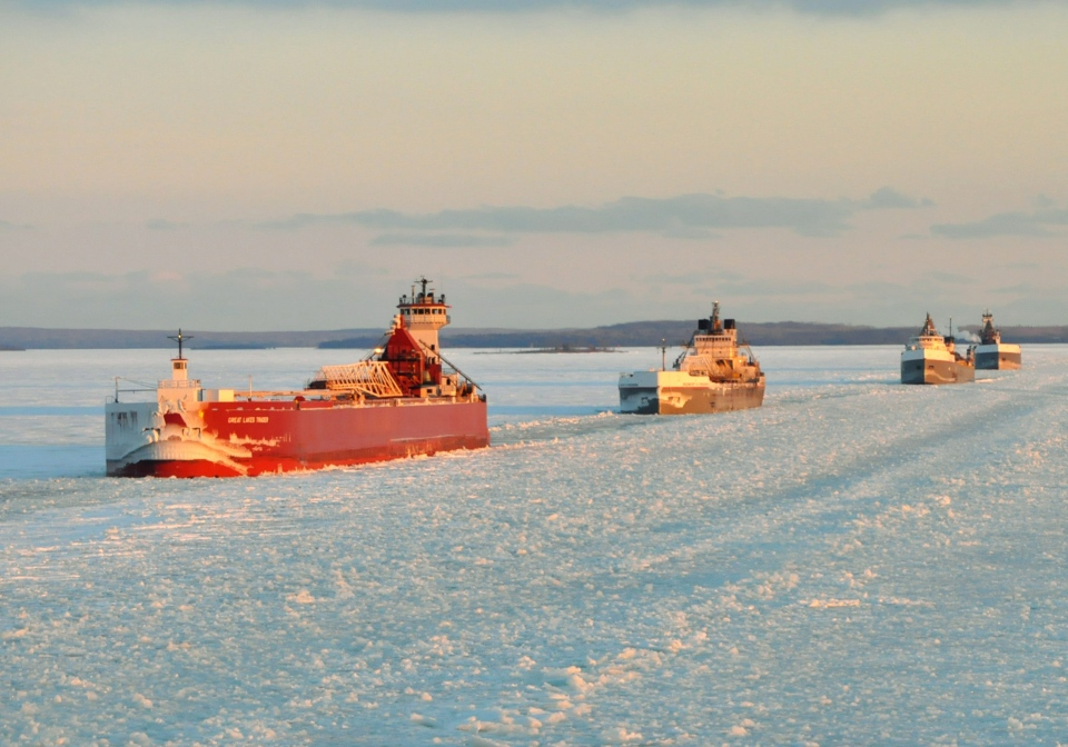 In this Jan. 9, 2014 file photo provided by the U.S. Coast Guard a convoy of Great Lakes cargo ships line up to follow an icebreaker on the St. Marys River, which links Lakes Superior and Huron. (AP / Lt. David Lieberman)