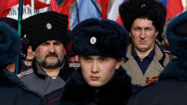 People dressed as Cossacks attend a rally just outside Moscow's Kremlin, Saturday, Feb. 21, 2015. (AP / Ivan Sekretarev)