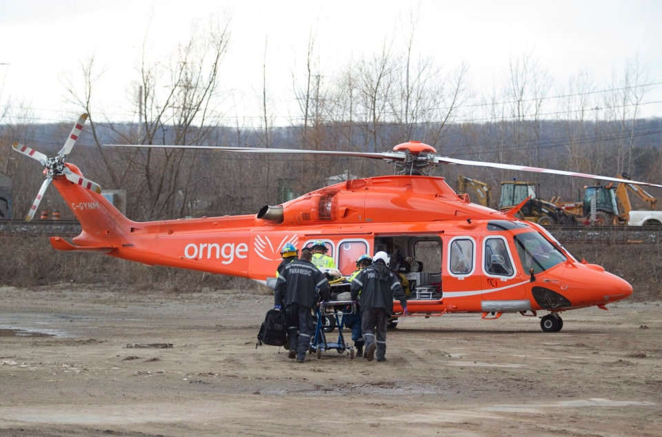 A patient is moved to an Ornge helicopter to be air lifted to hospital in this file photo from Sunday, February 26, 2012. (Pawel Dwulit /The Canadian Press)