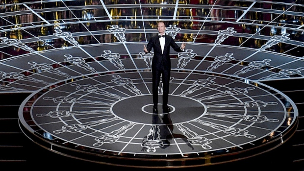 Host Neil Patrick Harris opens the Oscars ceremony at the Dolby Theatre in Los Angeles on Sunday, Feb. 22, 2015,. (Invision / John Shearer)