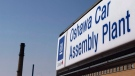 A sign stands outside Oshawa's General Motors car assembly plant in Oshawa, Canada.  (Michelle Siu / THE CANADIAN PRESS)