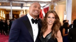 Dwayne Johnson, left, and Lauren Hashian arrive at the Oscars on Sunday, Feb. 22, 2015, at the Dolby Theatre in Los Angeles. (Chris Pizzello / Invision)