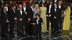 Alejandro G. Inarritu, centre, and the cast and crew of 'Birdman or (The Unexpected Virtue of Ignorance)' accept the award for the best picture at the Oscars at the Dolby Theatre in Los Angeles on on Sunday, Feb. 22, 2015. (John Shearer / Invision)