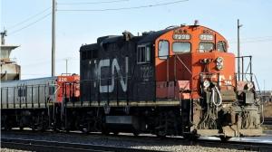 A CN Rail locomotive goes through the CN Taschereau yard in Montreal on Saturday, Nov., 28, 2009. (Graham Hughes / THE CANADIAN PRESS)