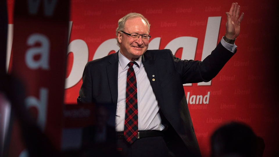 Wade MacLauchlan waves to the crowd as he is acclaimed leader at the Prince Edward Island Liberal leadership convention in Charlottetown on Saturday, Feb. 21, 2015. (Andrew Vaughan / THE CANADIAN PRESS)