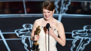 Julianne Moore accepts the award for best actress in a leading role for 'Still Alice' at the Oscars at the Dolby Theatre in Los Angeles on Sunday, Feb. 22, 2015. (AP / ohn Shearer)