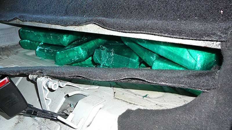 CBSA officers found a false compartment holding 35 kilograms of cocaine in a car at the Waneta crossing in July 2014. (Handout)