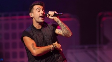 "Lead singer of Hedley, Jacob Hoggard, performs during ""We Day"" in Toronto on Thursday, Oct. 2, 2014. (Hannah Yoon / THE CANADIAN PRESS)"