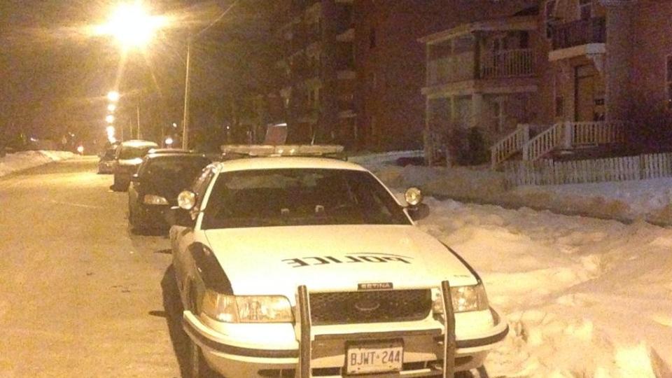 Windsor police investigate after a homicide on Bruce Avenue in Windsor, Ont., on Feb. 23, 2015. (Rich Garton / CTV Windsor)