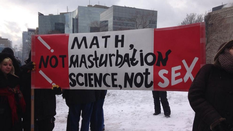 A sign is held up by those protesting Ontario's new sex ed curriculum in Toronto on Tuesday, Feb. 24, 2015. (Naomi Parness / CTV Toronto)