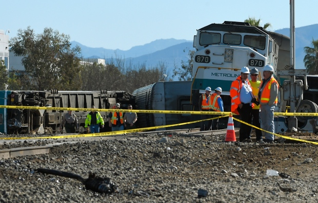 The burned wreckage of a truck that was hit by a Metrolink train that then derailed is shown at a train crossing, Tuesday, Feb. 24, 2015, in Oxnard, Calif. (AP / Mark J. Terrill)