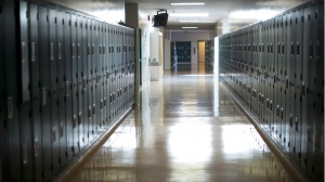 A empty hallway is seen at a Vancouver school in this Sept. 5, 2014 file photo. (Jonathan Hayward / THE CANADIAN PRESS)