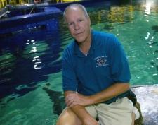 Veterinarian Bob George for the Virginia Aquarium in Virginia Beach, Va., is shown sitting in front of the turtle exhibit at the museum Wednesday, June 20, 2007 (AP / Gary C. Knapp)