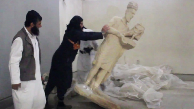 Vandals in the Ninevah Museum in Mosul, Iraq