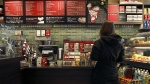 A customer places an order at a Starbucks in Chicago, on Dec. 5, 2012. (AP / Charles Rex Arbogast)