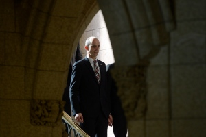 Public Safety Minister Steven Blaney arrives to talk to media about reports about Canadians going abroad to join ISIS, on Parliament Hill in Ottawa, Monday Feb 23, 2015 . (THE CANADIAN PRESS/Adrian Wyld)